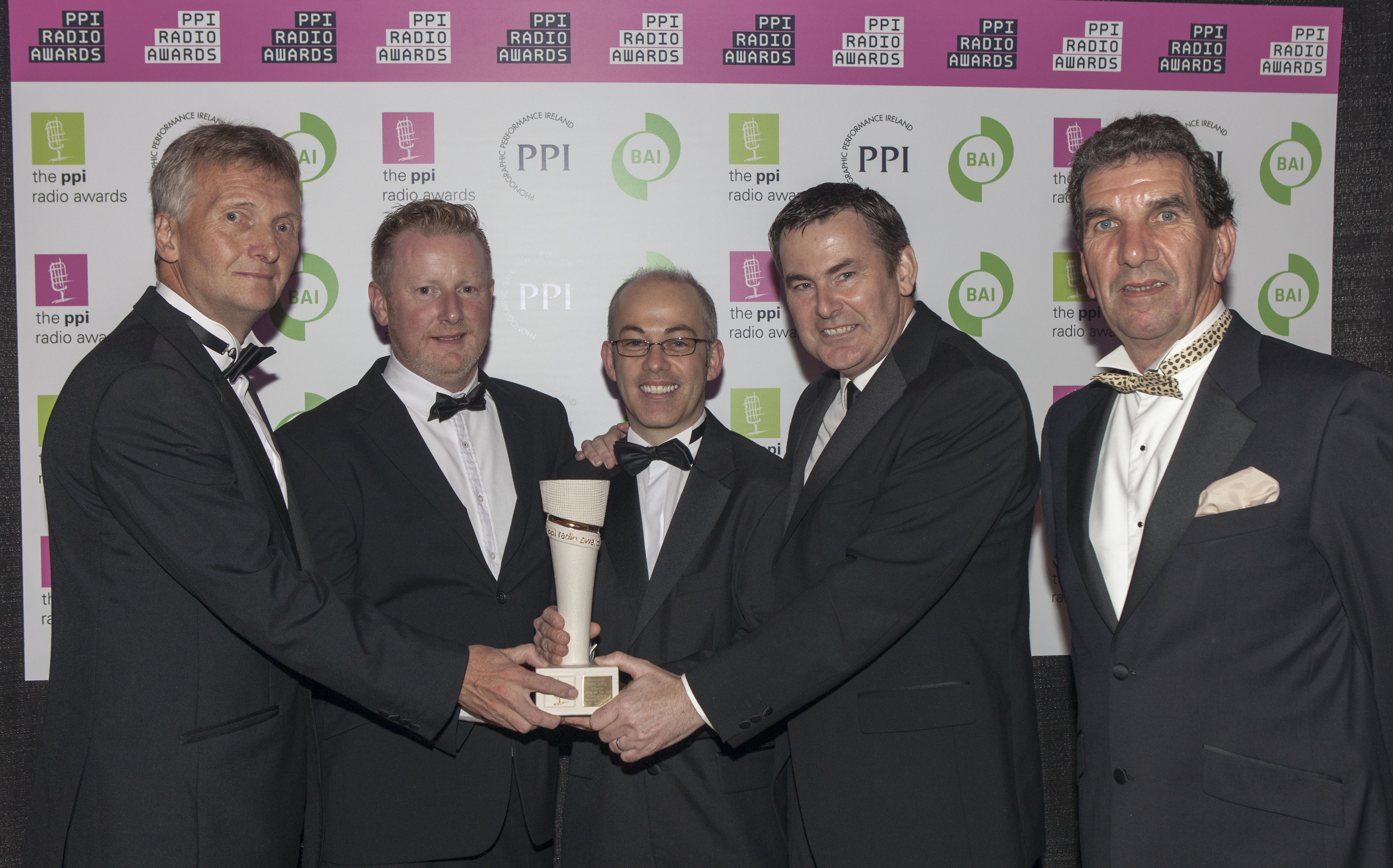 South East Radio's  Morning Mix won the Community/Social Action award for South East Radio's Dee Day Campaign at the PPI Radio Awards 2014 ceremony. Pictured receiving the award from Tom McGuire PPI Awards