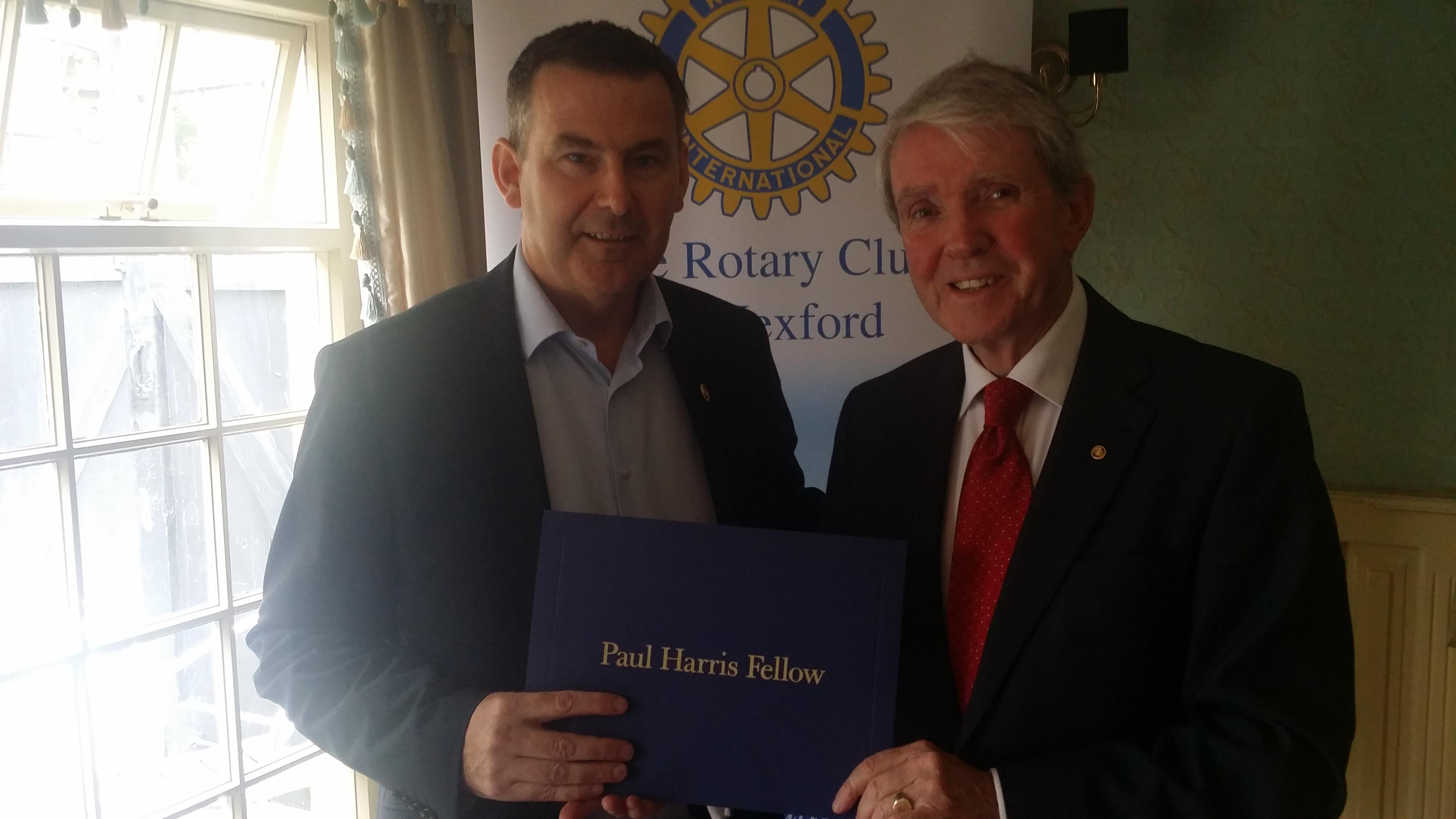Liam Dwyer receiving Paul Harris fellowship from Eddie Breen, President Wexford Rotary Club