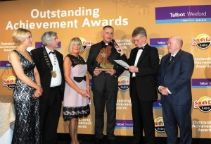 Fr Sean Devereax receiving his Overall Outstanding Achievement Award 2015 form Breda Morrison, Tony Dempsey, Lisa Carmody, Alan Corcoran and Michael Carruth