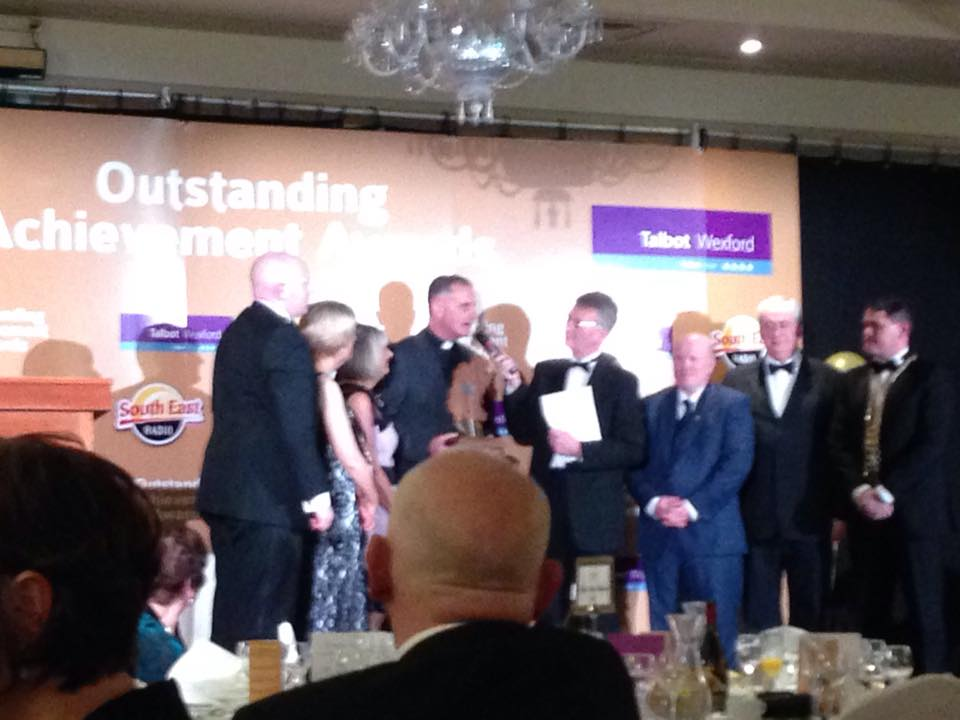 Fr Sean Devereux receiving the 2015 overall outstanding achievement award